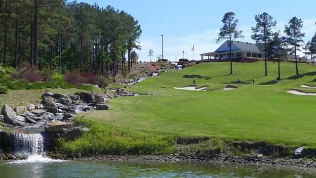 View of a green and clubhouse at Granada Golf Course