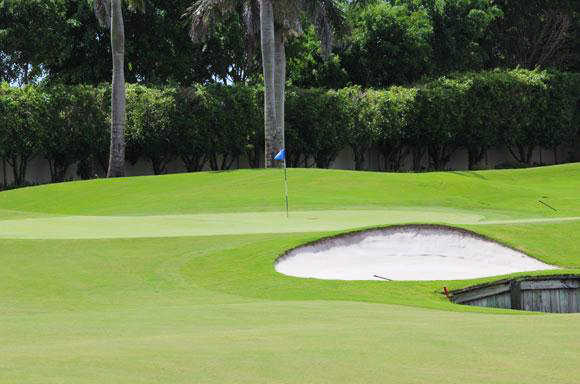 A view of the 3rd green at Mizner Country Club