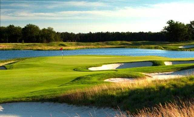A view of a bunkered green at Forest Dunes Golf Club