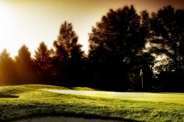 A sunny day view of a green at Belmont Country Club