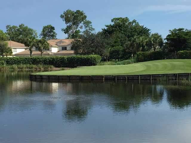 A view of green #18 surrounded by water at Forest Glen Golf & Country Club