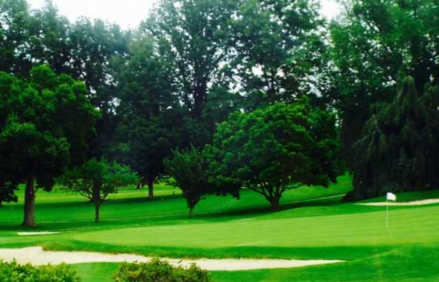 A view of a hole protected by sand traps at Plum Brook Country Club