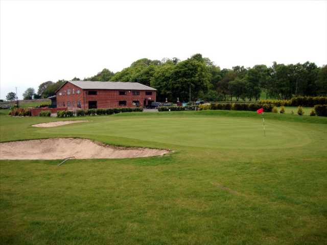 View overlooking the clubhouse and a manicured green at Halfpenny Green