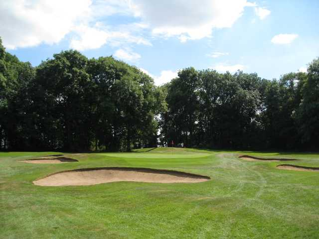 The 17th green and greenside bunkers at Rotherham Golf Club