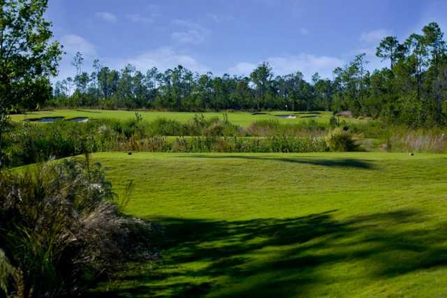 A sunny view of green #12 at The Preserve Golf Club
