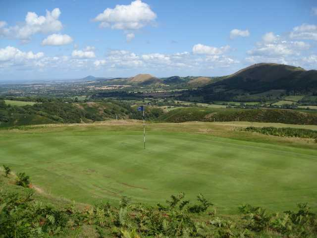 A view of the 7th green overlooking a stunning mountain backdrop at Church Stretton Golf Club
