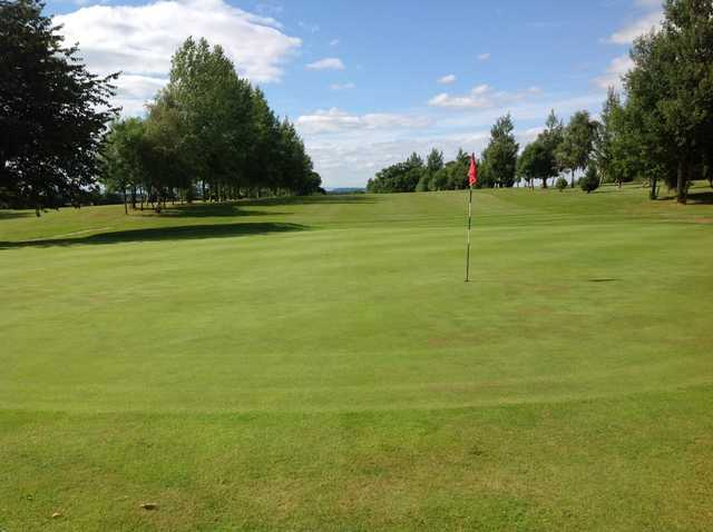 A view of the 9th green and tree lined fairway at Arscott