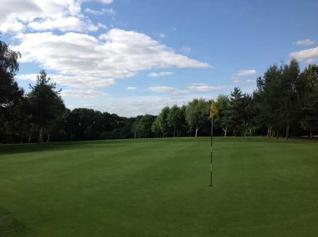 Arscott GC: the 5th hole surrounded by trees
