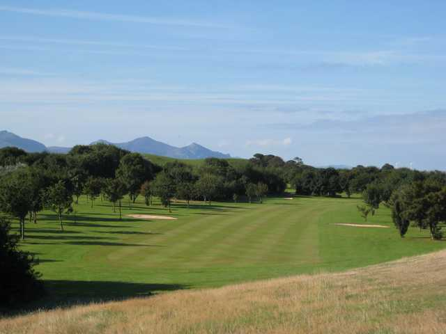 A view of the 16th fairway and surrounding mountains at  Caernarfon Golf Club