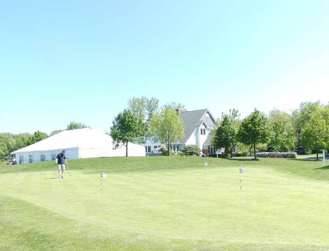 A view of a hole at Bittersweet Golf Club with a white tent for special events in background
