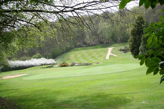 A shot of the tree lined green at the Hazlemere Golf Club