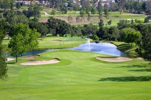 A view of hole #13 with water in background at Anaheim Hills Public Country Club