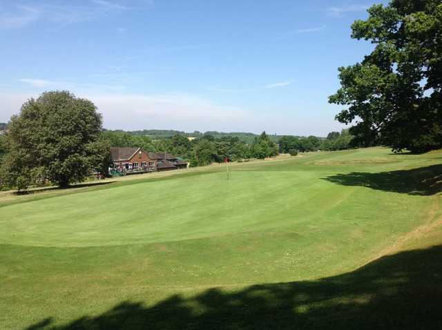 A view of the 18th green overlooking the clubhouse at Chipstead Golf Club