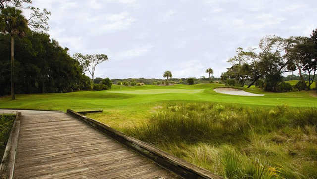 A view over a wooden bridge from Long Point at Amelia Island Club