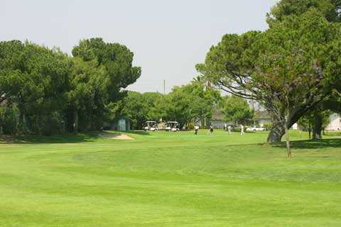 A view of hole #14 with golf carts in background at Dad Miller Golf Course