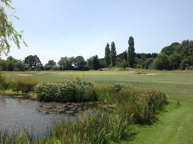 A view of the first green and neighbouring pond at Foxbridge Golf Club