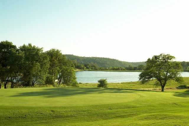 A view of a green with water in background at Auburn Valley Golf Club