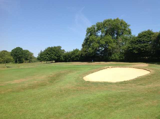 A view of the 17th green and greenside bunker at Hamptworth Golf Club