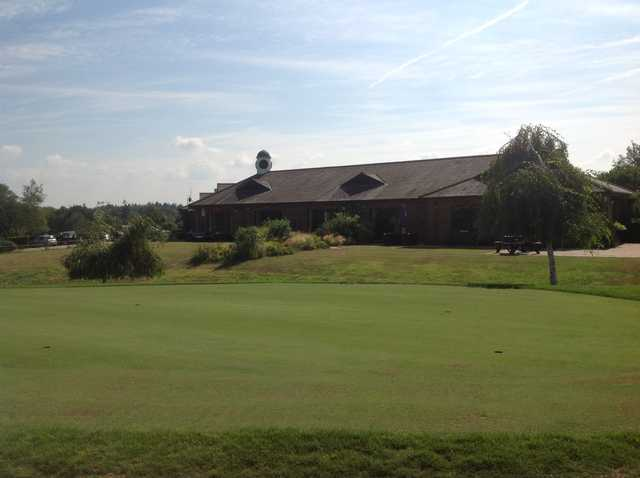 A view of the putting green and clubhouse at Hamptworth Golf Club