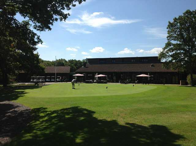 View of the putting green and pro shop at Leatherhead Golf Club
