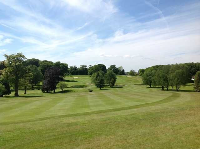 The well-kept fairway leading to the 10th green at Shaw Hill Golf Club