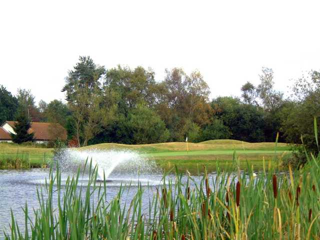 The 8th green including fountain at Orton Meadows Golf Club