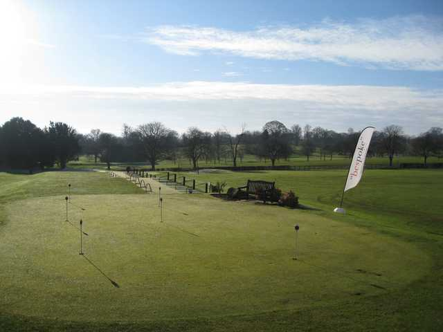 View from the clubhouse of the putting green and driving range at The Welcombe Golf Club