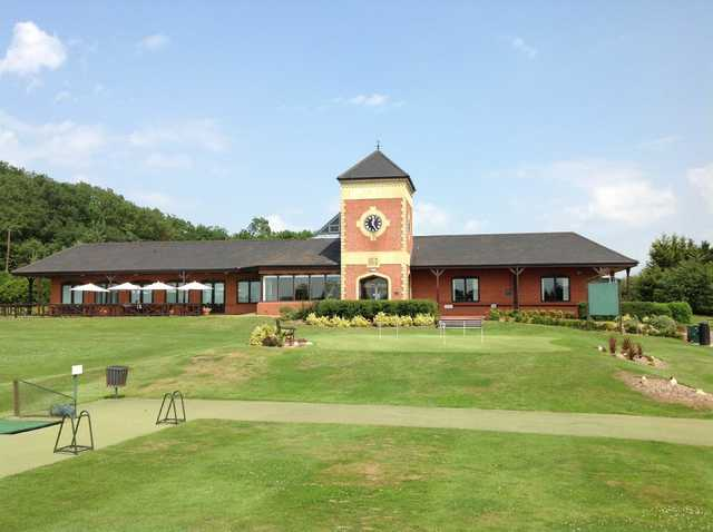 View of the clubhouse, putting green and raneg bay at The Welcombe Golf Club