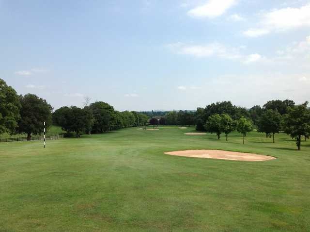 A scenic view of the challenging 18th hole at The Welcombe Golf Club