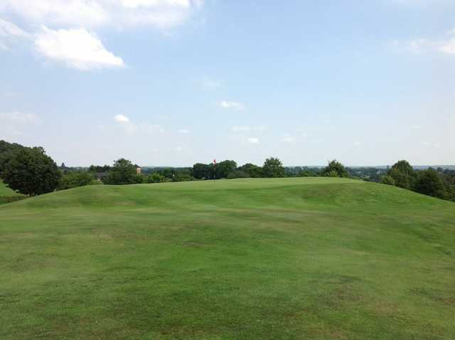 View of the 17th hole on a hill at The Welcombe Golf Club