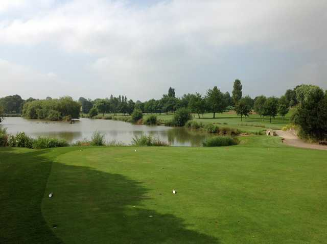A view of the 14th hole and neighbouring lake at Windmill Village Golf Club