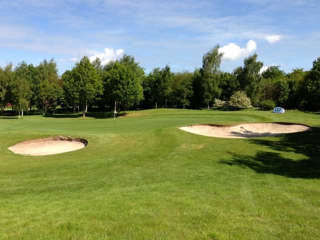 A bunker-guarded green at Puckrup Hall Golf Club