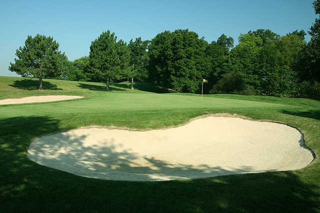 View of a green with two bunkers at Quicksilver Golf Club