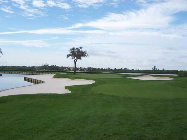 A view of a green protected by bunkers at John's Island Club
