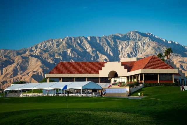 A view of the clubhouse at Desert Dunes Golf Course  with green in foreground