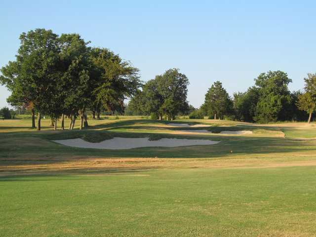 View of a green and bunkers at Arrowhead State Park Golf Course