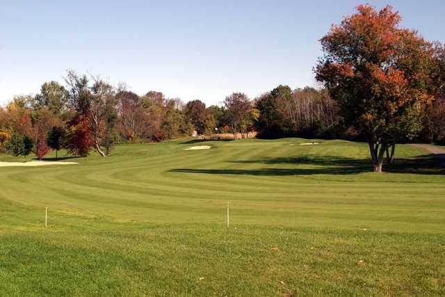 Fall view of a fairway and green at Blackledge Country Club