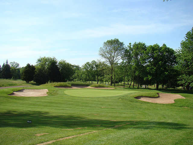 A view of a bunkered green at Quail Brook Golf Course