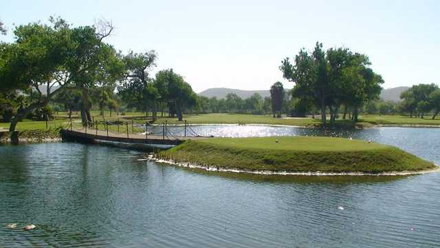 A tee view surrounded by water at Cottonwood at Rancho San Diego