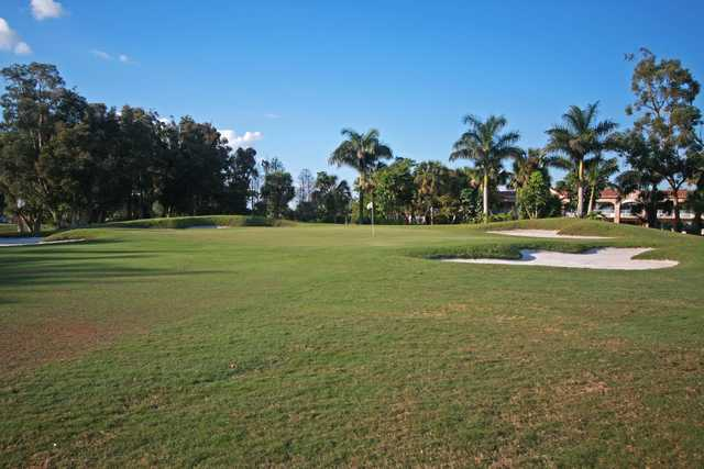 A view of a bunkered green at Grand Palms Golf & Country Club
