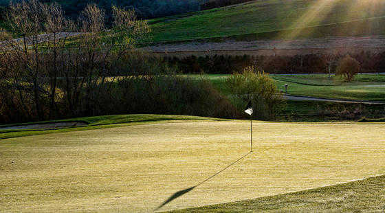 A sunny view of a green at Empire Ranch Golf Club