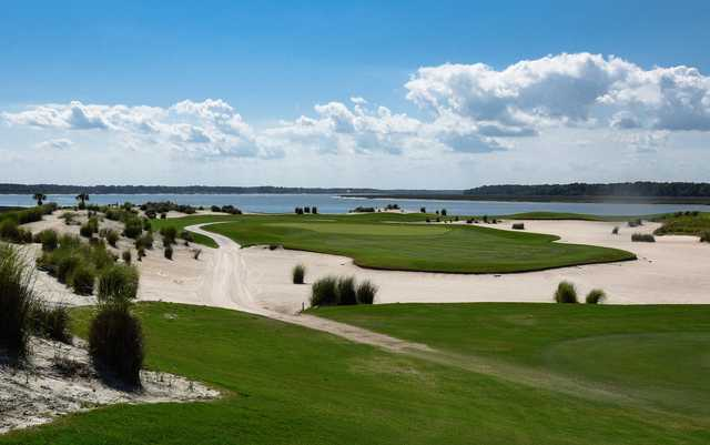 A view of the 16th hole surrounded by sand traps at Colleton River Club.