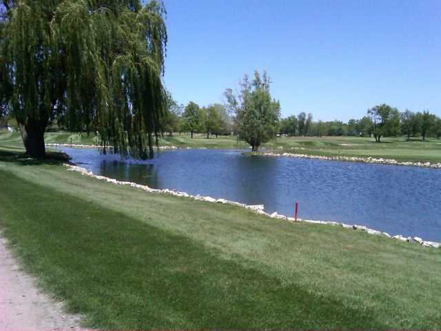 A view over the pond of hole #2 at Juday Creek Golf Course