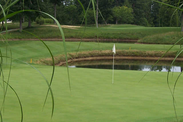 A view of a green protected by a pond at Hillcrest Country Club