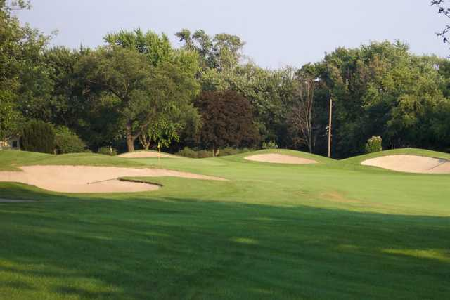 A view of a green defended by tricky sand traps at Youche Country Club