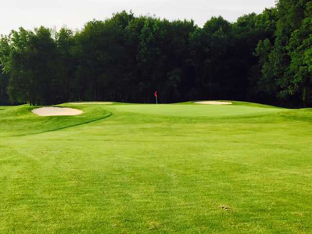A view of a hole defended by sand traps at Green Acres Golf Club