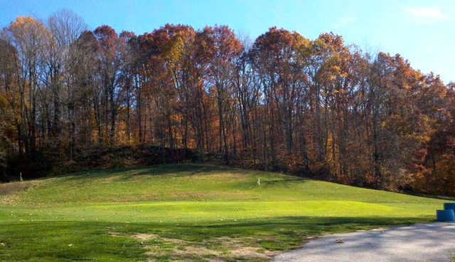 A fall day view of a green at Pine Woods Golf Course
