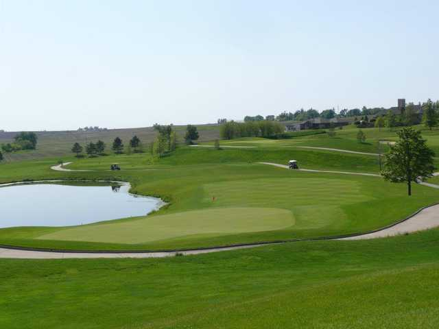 A view of a green with water coming into play at Stone Creek Golf Club