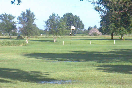 A sunny day view of a green at Tee Time Golf & Cafe
