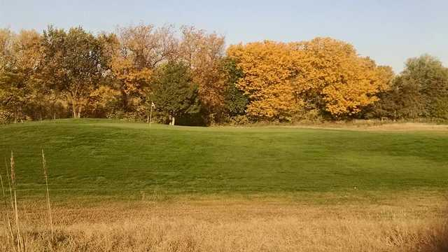 A fall day view of a green at Indian Hill Golf Course